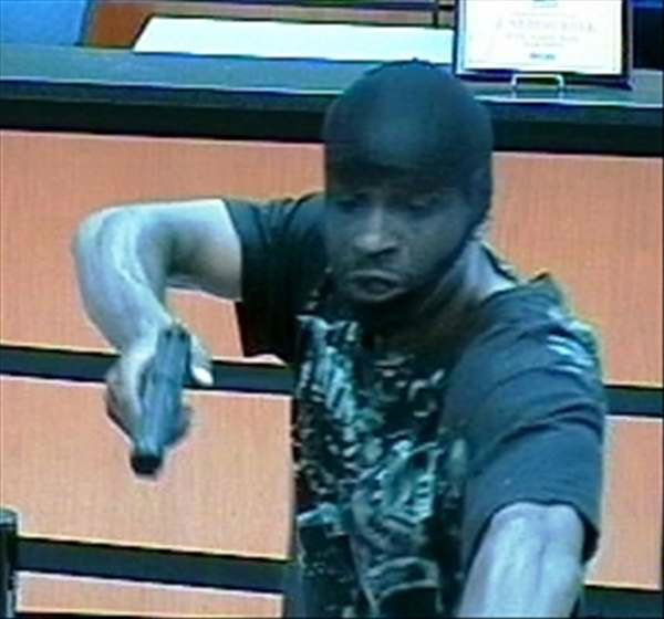 Durham police are investigating a bank robbery that happened late Thursday afternoon at the SunTrust Bank branch in the 3400 block of Hillsborough Road. <span class=meta>(WTVD Photo&#47; Durham Police Dept.)</span>