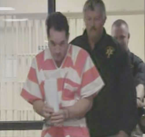 John Violette being transferred in prison garb. <span class=meta>(WTVD Photo)</span>