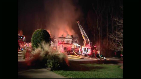 "<div class=""meta ""><span class=""caption-text "">At least five fire departments were called to the scene of a huge house fire Wednesday evening on Swithland Court. (WTVD Photo)</span></div>"