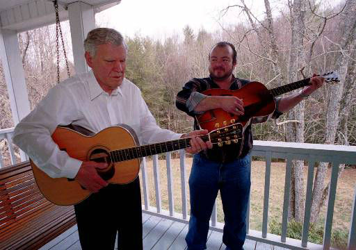 Legendary bluegrass guitarist Doc Watson, left, and his grandson, Richard Watson, practice Wednesday March 15, 2000, on the back porch of Watson's home in Deep Gap, N.C.  (AP Photo/Karen Tam)