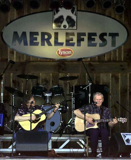 Music legend Doc Watson, right, along with Jack Lawrence, perform at the 14th annual Merlefest at Wilkes Comunity College in Wilkesboro, N.C., Saturday, April 28, 2001. The festival attracts more than a hundred musicians. The festival is held in memory of Watson's son, Eddy Merle Watson, who was also a musician. (AP Photo/Alan Marler)