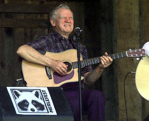 Music legend Doc Watson performs at the annual Merlefest at Wilkes Comunity College in Wilkesboro, N.C. Watson was in critical condition Thursday, May 24, 2012 at a North Carolina hospital after falling at his home in Deep Gap earlier this week.  (AP Photo/Alan Marler, File)