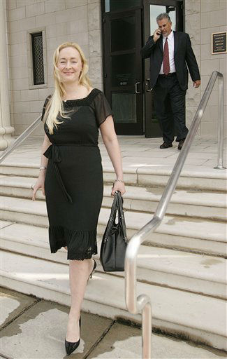Country musician Mindy McCready, left, leaves the Williamson County circuit court after a motion to withdraw her guilty plea for a probation violation based upon new evidence was accepted during her sentencing hearing in Franklin, Tenn., Tuesday, Aug. 22, 2006. McCready now awaits sentencing for a charge of driving on a revoked license in Nashville.(AP Photo/John Russell)
