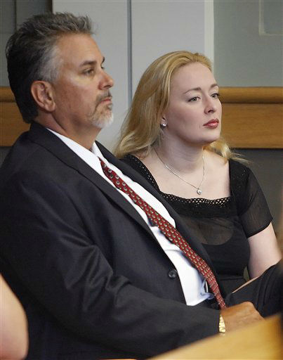Country musician Mindy McCready, right, sits with her stepfather Michael Inge as they listen to her attorney file a motion to withdraw her guilty plea for a probation violation based upon new evidence during her sentencing hearing in Franklin, Tenn., Tuesday, Aug. 22, 2006. The motion was granted and McCready now awaits sentencing for a charge of driving on a revoked license in Nashville.(AP Photo/John Russell)