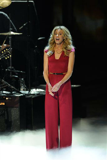 "<div class=""meta image-caption""><div class=""origin-logo origin-image ""><span></span></div><span class=""caption-text"">Faith Hill performs during the People's Choice Awards on Wednesday, Jan. 11, 2012 in Los Angeles. (AP Photo/Chris Pizzello)</span></div>"