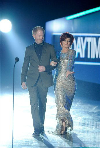 Jesse Tyler Ferguson and Sharon Osbourne on stage during the People's Choice Awards on Wednesday, Jan. 11, 2012 in Los Angeles.