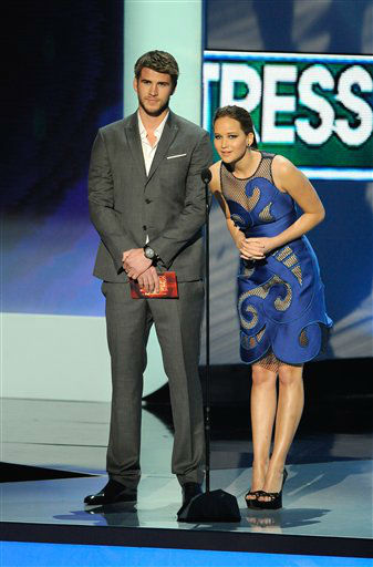 Liam Hemsworth and Jennifer Lawrence on stage during the People's Choice Awards on Wednesday, Jan. 11, 2012 in Los Angeles.