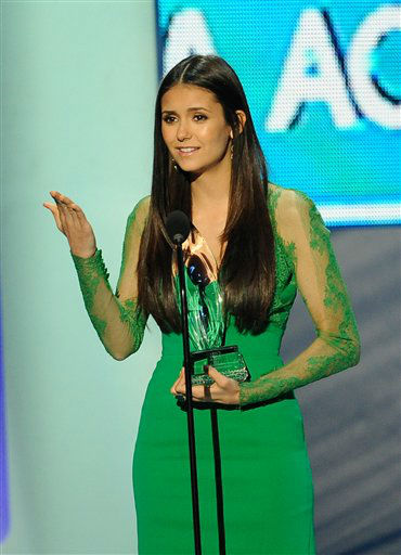 Nina Dobrev accepts an award during the People's...