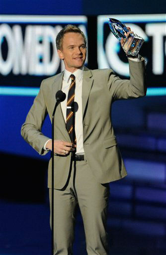 Neil Patrick Harris accepts an award during the...