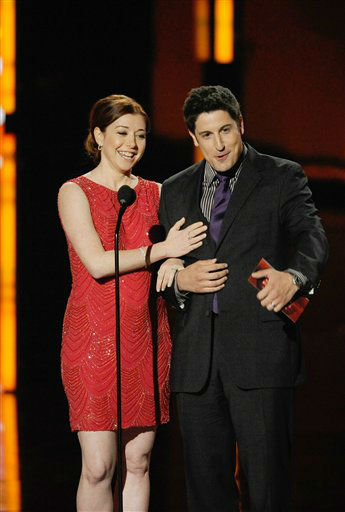 Alyson Hannigan and Jason Biggs on stage during...