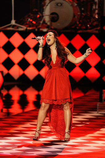 "<div class=""meta ""><span class=""caption-text "">Demi Lovato perfoms during the People's Choice Awards on Wednesday, Jan. 11, 2012 in Los Angeles. (AP Photo/Chris Pizzello)</span></div>"