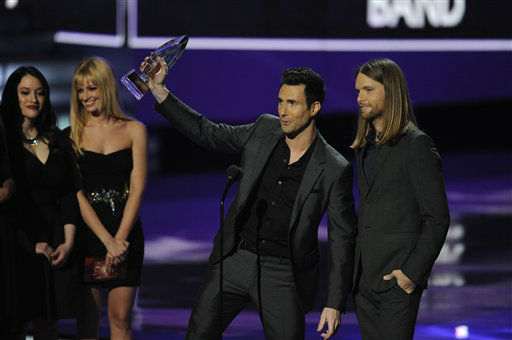 "<div class=""meta image-caption""><div class=""origin-logo origin-image ""><span></span></div><span class=""caption-text"">Maroon Five accepts an award during the People's Choice Awards on Wednesday, Jan. 11, 2012 in Los Angeles.  (AP Photo/ Chris Pizzello)</span></div>"
