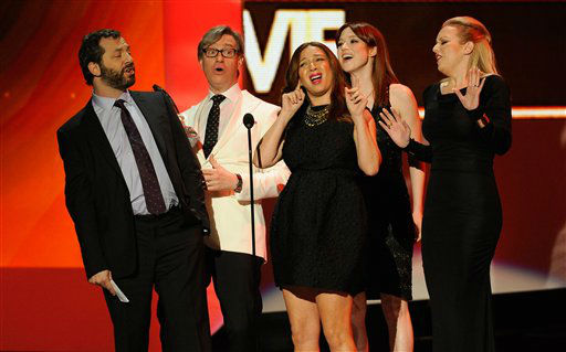 "<div class=""meta ""><span class=""caption-text "">The cast of Bridesmaids and Direct Judd Apatow accept an award during the People's Choice Awards on Wednesday, Jan. 11, 2012 in Los Angeles. (AP Photo/Chris Pizzello)</span></div>"