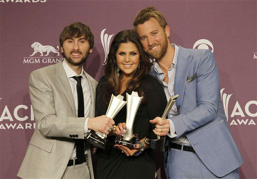 From left, Dave Haywood, Hillary Scott and Charles Kelley, of musical group Lady Antebellum, pose backstage with the award for vocal group of the year at the 47th Annual Academy of Country Music Awards on Sunday, April 1, 2012 in Las Vegas. (AP Photo/Isaac Brekken)
