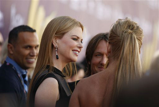 Nicole Kidman, left, and Keith Urban arrive at the 47th Annual Academy of Country Music Awards on Sunday, April 1, 2012 in Las Vegas. (AP Photo/Isaac Brekken)