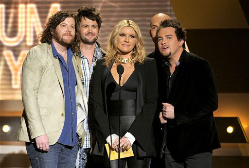 Grace Potter, center, and from left, James Young, Chris Thompson, Jon Jones and Mike Eli of musical group Eli Young Band present the award for album of the year at the 47th Annual Academy of Country Music Awards on Sunday, April 1, 2012 in Las Vegas. (AP Photo/Mark J. Terrill)