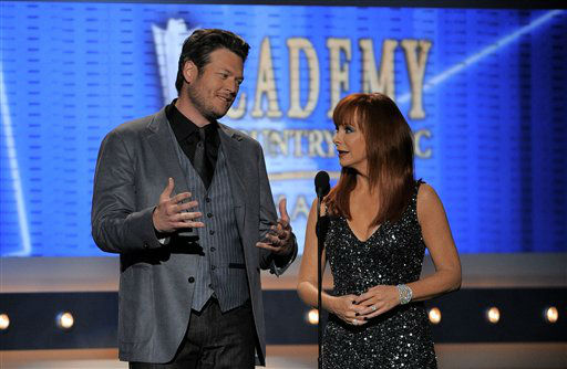 Hosts Blake Shelton, left, and Reba McEntire speak onstage at the 47th Annual Academy of Country Music Awards on Sunday, April 1, 2012 in Las Vegas. (AP Photo/Mark J. Terrill)