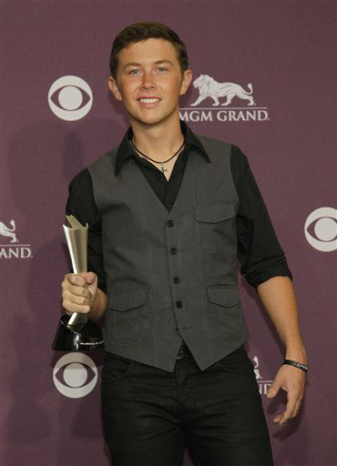 Scotty McCreery poses backstage with the award for new artist of the year at the 47th Annual Academy of Country Music Awards on Sunday, April 1, 2012 in Las Vegas. (AP Photo/Isaac Brekken)