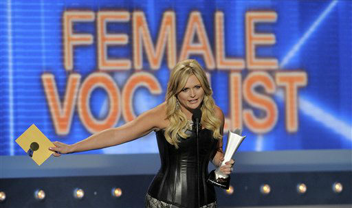 Miranda Lambert accepts the award for female vocalist of the year at the 47th Annual Academy of Country Music Awards on Sunday, April 1, 2012 in Las Vegas. (AP Photo/Mark J. Terrill)