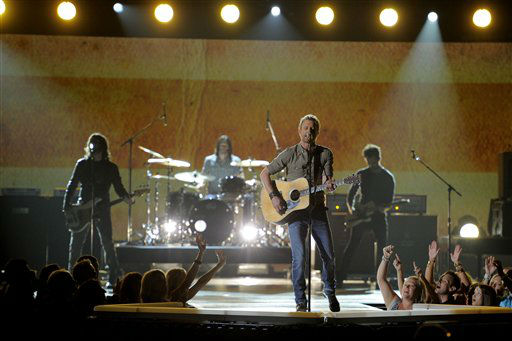 Dierks Bentley performs at the 47th Annual Academy of Country Music Awards on Sunday, April 1, 2012 in Las Vegas. (AP Photo/Mark J. Terrill)