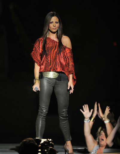 Sara Evans performs at the 47th Annual Academy of Country Music Awards on Sunday, April 1, 2012 in Las Vegas. (AP Photo/Mark J. Terrill)