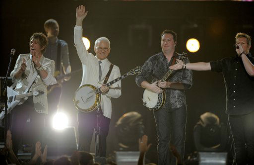 Steve Martin, second left, Travis Toy, second right, and musical group Rascal Flatts' Joe Don Rooney, left, and Gary LeVox, right, perform at the 47th Annual Academy of Country Music Awards on Sunday, April 1, 2012 in Las Vegas. (AP Photo/Mark J. Terrill)