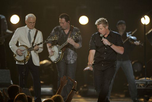 From left, Steve Martin, Travis Toy and musical group Rascal Flatts' Gary LeVox perform at the 47th Annual Academy of Country Music Awards on Sunday, April 1, 2012 in Las Vegas. (AP Photo/Mark J. Terrill)