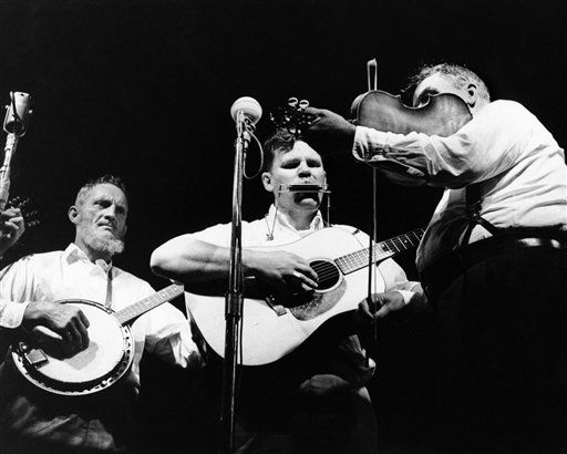 From Dixie, the Watson Family with Doc Watson, center, were on the opening night program of the Newport Folk Festival in Newport, Rhode Island on July 24, 1963. (AP Photo)