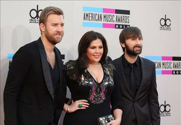 "<div class=""meta image-caption""><div class=""origin-logo origin-image ""><span></span></div><span class=""caption-text"">From left, Charles Kelley, Hillary Scott, and Dave Haywood of the musical group Lady Antebellum arrives at the 2013 American Music Awards, on Sunday, Nov. 24, 2013 in Los Angeles.  (Photo by Matt Sayles/Invision/AP)</span></div>"
