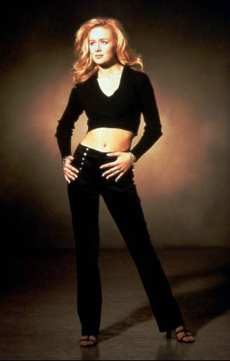 "FOR USE WITH FEATURE PACKAGE FOR SUNDAY, NOV. 17--Country singer Mindy McCready, shown in this 1996 file photo, is not quite 21 and lives with her 17-year-old brother in Nashville, Tenn. The oldest country music influences she mentions are the 1980s' big-time acts such as Alabama and the Oak Ridge Boys.  Although her music career is young, McCready has come up with two No. 1 hits with her first two singles, ""Ten Thousand Angels"" and ""Guys Do It All The Time."" (AP Photo)"