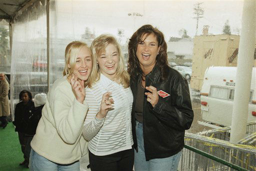 Country music singers Mindy McCready, left, LeAnn Rimes and Terri Clark joke around after a rehearsal for the American Music Awards at the Shrine Auditorium in Los Angeles, Jan. 26, 1997. The awards will be announced on Monday in evening. (AP Photo/Michael Caulfield)