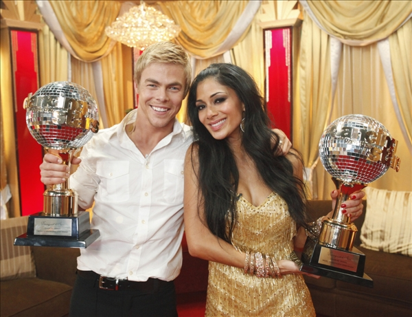In this image provided by ABC, Nicole Scherzinger and partner Derek Hough pose with their trophies after dominating throughout the 10th season of the hit ABC show &#34;Dancing with the Stars&#34; and bested Olympic gold medalist Evan Lysacek to win the crown Tuesday night May 25, 2010. <span class=meta>(AP&#47;ABC - Kelsey McNeal)</span>