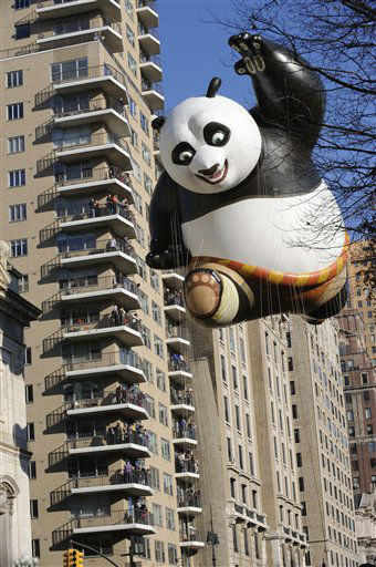 The Kung Fu Panda balloon passes an apartment...
