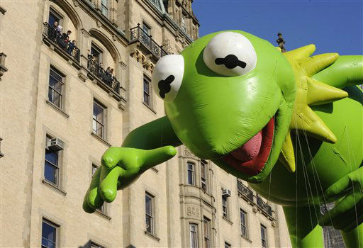 The Kermit The Frog balloon makes its way down...
