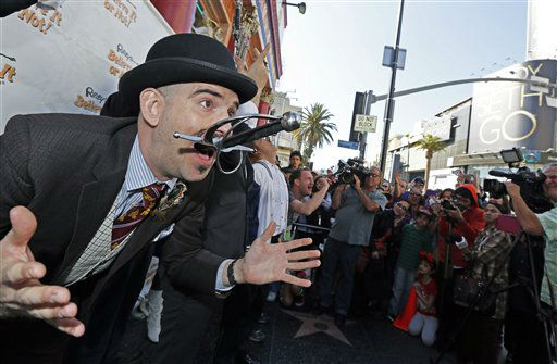 Brett Laudermilk swallows a sword in front of Ripley&#39;s Believe It Or Not! at the Hollywood and Highland complex in the Hollywood section of Los Angeles on Saturday, Feb. 23, 2013.  Ripley&#39;s was celebrating a sword swallowers day as the area prepares for Sunday night&#39;s Academy Awards at the Dolby Theatre.   <span class=meta>(AP Photo&#47; Reed Saxon)</span>