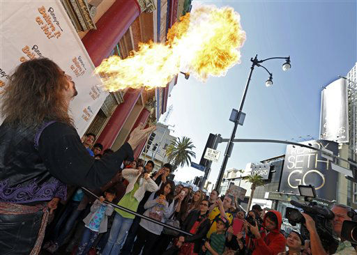 A fireeater known as &#34;Ted Shred&#34; performs in front of Ripley&#39;s Believe It Or Not! at the Hollywood and Highland complex in the Hollywood section of Los Angeles on Saturday, Feb. 23, 2013, as the area prepares for Sunday night&#39;s Academy Awards at the Dolby Theatre.   <span class=meta>(AP Photo&#47; Reed Saxon)</span>