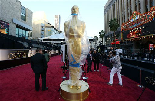 A statue in the likeness of an Oscar award is displayed on the red carpet for the 85th Academy Awards in Los Angeles, Saturday, Feb. 23, 2013.  <span class=meta>(AP Photo&#47;Matt Sayles)</span>