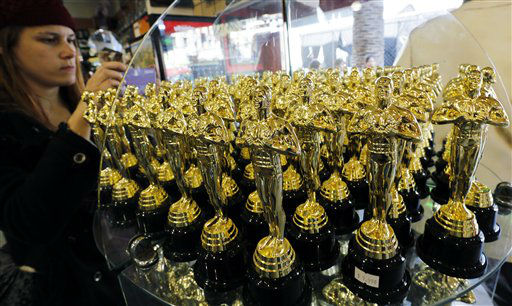A woman photographs statuettes in the likeness of the Oscar award displayed across the street from the Hollywood and Highland complex ahead of Sunday night&#39;s Academy Awards in the Hollywood section of Los Angeles on Saturday, Feb. 23, 2013.   <span class=meta>(AP Photo&#47; Reed Saxon)</span>