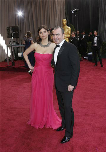"<div class=""meta image-caption""><div class=""origin-logo origin-image ""><span></span></div><span class=""caption-text"">Editor Sari Gilman, left, and producer Jedd Wider arrive at the 85th Academy Awards at the Dolby Theatre on Sunday Feb. 24, 2013, in Los Angeles.  (AP Photo/ Todd Williamson)</span></div>"