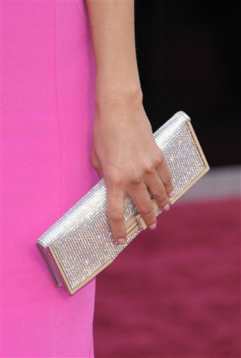 "<div class=""meta image-caption""><div class=""origin-logo origin-image ""><span></span></div><span class=""caption-text"">TV personality Maria Menounos (handbag detail) arrives at the 85th Academy Awards at the Dolby Theatre on Sunday Feb. 24, 2013, in Los Angeles.  (AP Photo/ John Shearer)</span></div>"