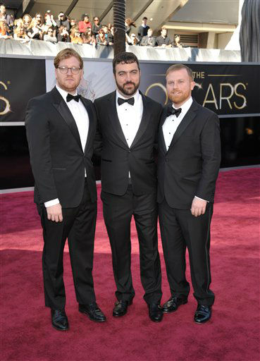 From left, Beasts of Southern Wild producers Dan Janvey, Josh Penn and Michael Gottwald arrive at the 85th Academy Awards at the Dolby Theatre on Sunday Feb. 24, 2013, in Los Angeles. (Photo by John Shearer/Invision/AP)