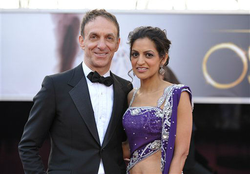 Composers Mychael Danna, left, and Bombay Jayashri arrive at the 85th Academy Awards at the Dolby Theatre on Sunday Feb. 24, 2013, in Los Angeles. <span class=meta>(AP Photo&#47; John Shearer)</span>
