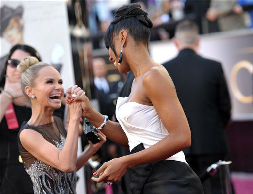 Actress Kristin Chenoweth  and singer Kelly Rowland arrive at the 85th Academy Awards at the Dolby Theatre on Sunday Feb. 24, 2013, in Los Angeles.  <span class=meta>(AP Photo&#47; John Shearer)</span>