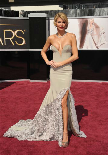 "<div class=""meta image-caption""><div class=""origin-logo origin-image ""><span></span></div><span class=""caption-text"">TV personality Brandi Glanville arrives at the 85th Academy Awards at the Dolby Theatre on Sunday Feb. 24, 2013, in Los Angeles.  (AP Photo/ John Shearer)</span></div>"