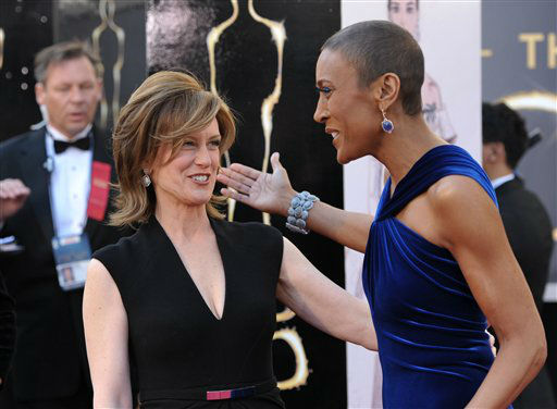 Co-Chair of Disney Media Networks and President of Disney-ABC Television Group Anne Sweeney and Tv personality Robin Roberts arrives at the 85th Academy Awards at the Dolby Theatre on Sunday Feb. 24, 2013, in Los Angeles. (Photo by John Shearer/Invision/AP)