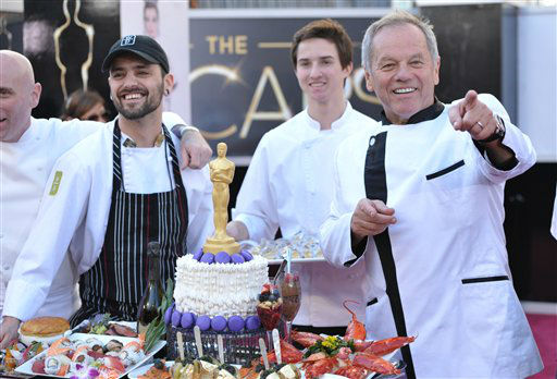 Celebrity chef Wolfgang Puck displays a platter of food the 85th Academy Awards at the Dolby Theatre on Sunday Feb. 24, 2013, in Los Angeles.  <span class=meta>(AP Photo&#47; John Shearer)</span>