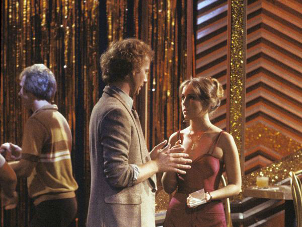 1970s: Luke hires Laura at the campus disco - Short on cash, Laura asks Luke for a job at the campus disco. It&#39;s there that Luke later professes his love for - and but then rapes - Laura.   <span class=meta>(ABC Photo)</span>