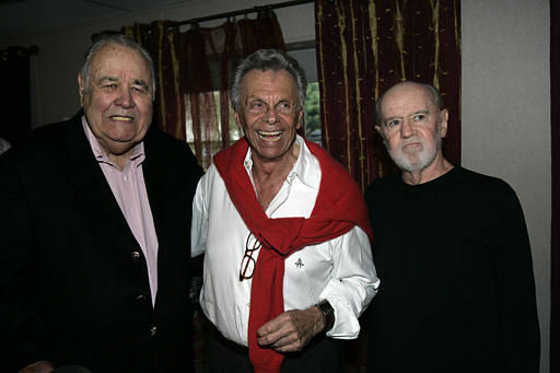 "<div class=""meta image-caption""><div class=""origin-logo origin-image ""><span></span></div><span class=""caption-text"">Jonathan Winters, left, Mort Sahl and George Carlin pose for photographs at the 80th birthday ""Sahl-ute"" honoring Sahl, at Wadsworth Theater in the Brentwood area of Los Angeles on Thursday, June 28, 2007.  (AP Photo/ ANN JOHANSSON)</span></div>"