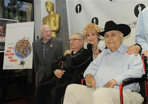 Karen Kramer, second from right, widow of director Stanley Kramer, poses with &#34;It&#39;s a Mad, Mad, Mad, Mad World&#34; cast members, from left, Mickey Rooney, Marvin Kaplan and Jonathan Winters at The Last 70mm Film Festival Presented by the Academy of Motion Picture Arts and Sciences, Monday, July 9, 2012, at the Samuel Goldwyn Theater in Beverly Hills, Calif.  <span class=meta>(AP Photo&#47; Chris Pizzello)</span>