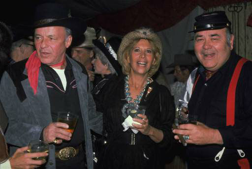 Frank Sinatra, left, celebrates his 65th birthday party with Jonathan Winters and Dinah Shore at Rancho Mirage in Palm Springs, Calif., December 12, 1980.   <span class=meta>(AP Photo&#47; REED SAXON)</span>